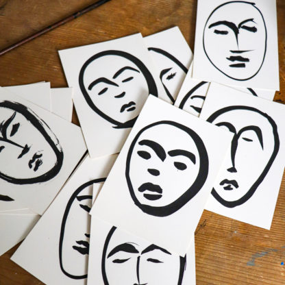 Hand drawn faces in ink by Ella Johnston