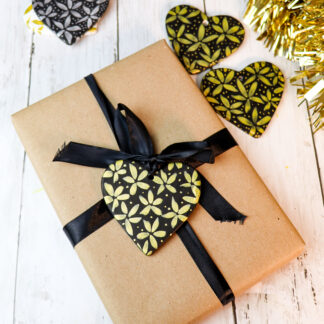 Gold on black ceramic hearts
